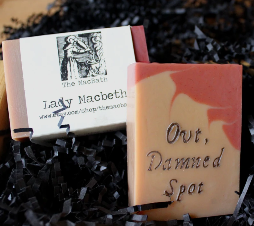 A beige and orange soap with black letters spelling Ovt, damned spot
