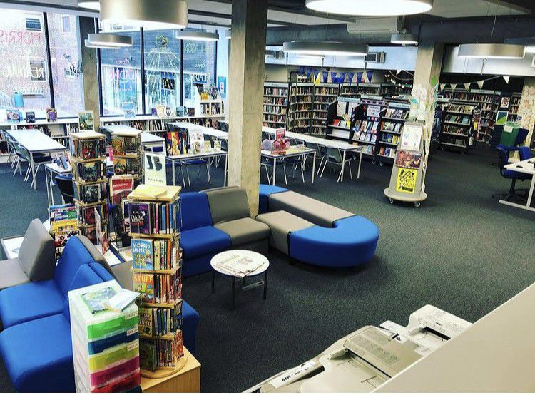 A photo of Glenthorne High School Library, showing lots of seating, book displays, and face-out books.