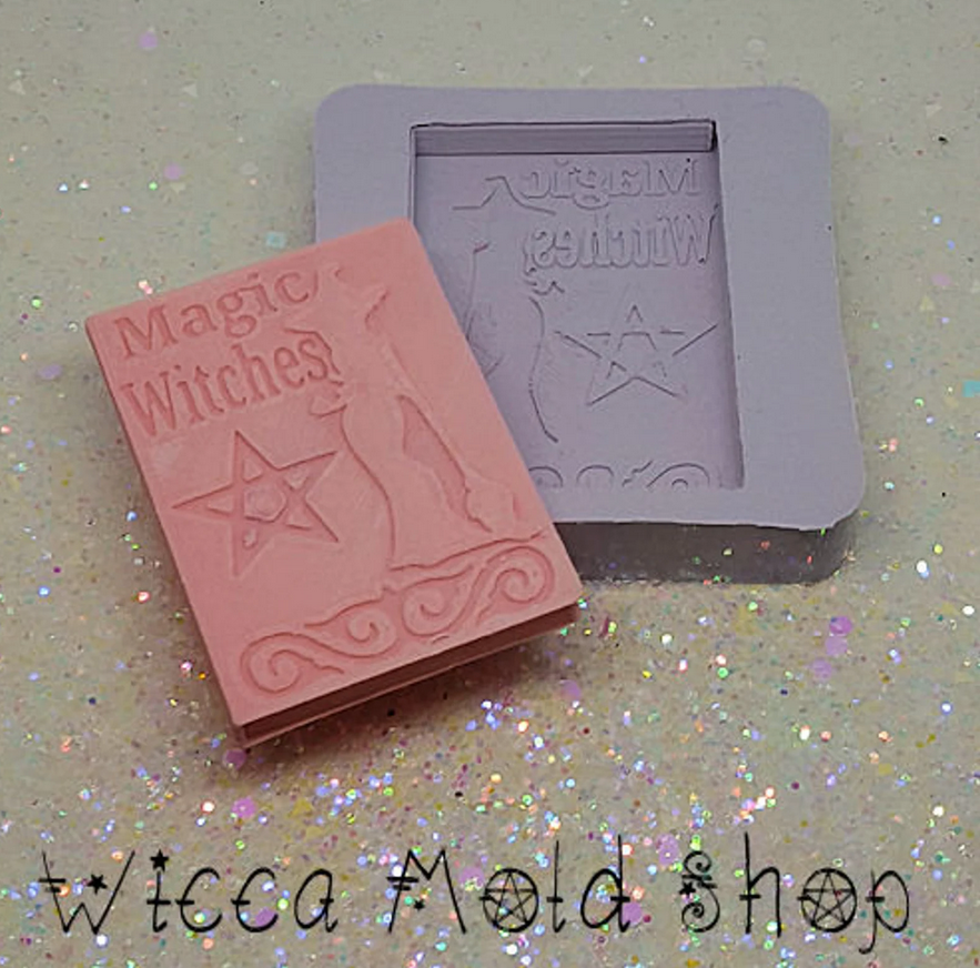 image of a mold with a book with the title Magic Witches and the soap it makes in dark red colour