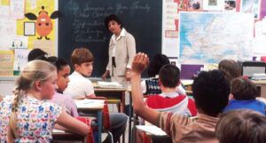 image of a middle school classroom with students and a teacher