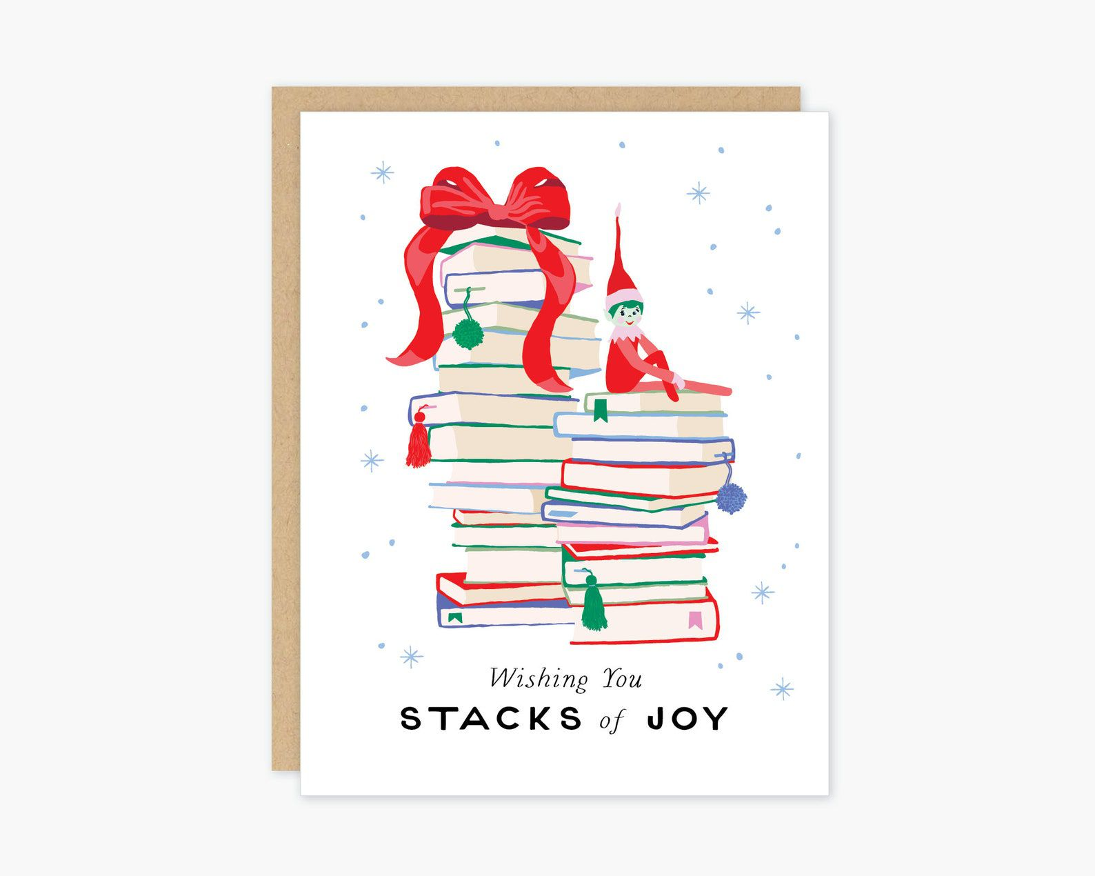 A white card depicting stacks of books decorated with ribbon, and a small elf.