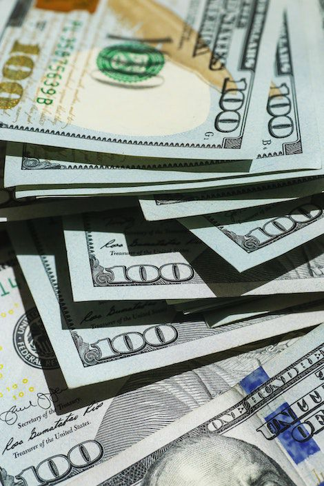 Stacks of $100 US bills | How Much Can You Make Writing Romance? | BookRiot.com