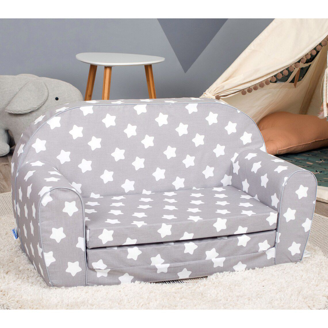 small gray couch with white stars all over