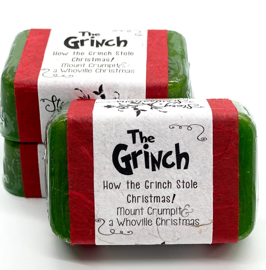 Photo of a dark green bar of soap with a white and red label saying the grinch
