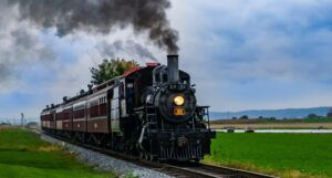 a steam engine train on train tracks