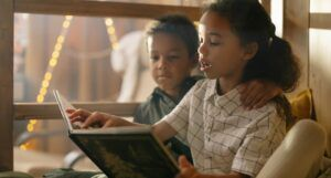 two kids reading together