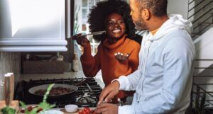 people smiling and cooking