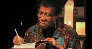 Octavia Butler signing a book