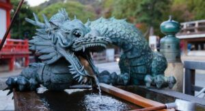 image of a green dragon statue in kyoto
