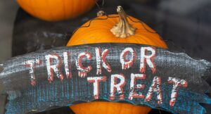 Image of a trick or treat sign with two pumpkins