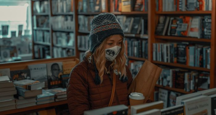 woman wearing a face mask in a bookstore