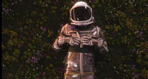 person in a space suit in a field of flowers