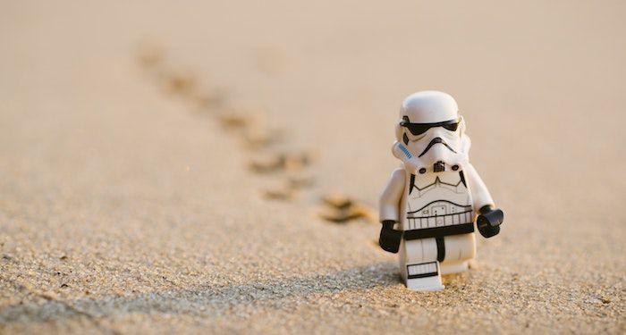 stormtrooper lego figure on sand