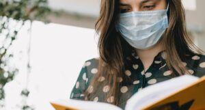 woman reading wearing mask